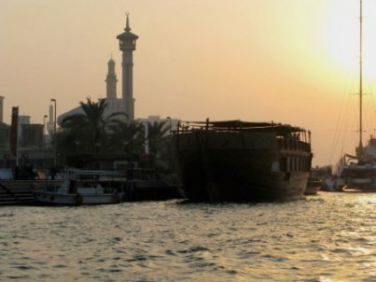 Al Bastakiya Mosque from Dubai Creek water taxi at sunset