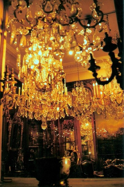 Antique shop chandeliers at night in Paris