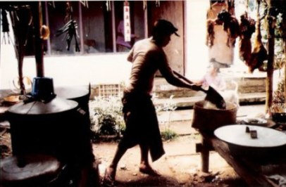 Bali village wedding feast rice on shovel