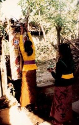 Bali village wedding hanging of offerings