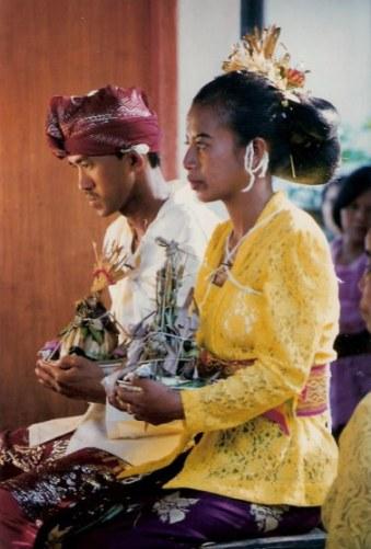 Bali village wedding offerings for bridal pair