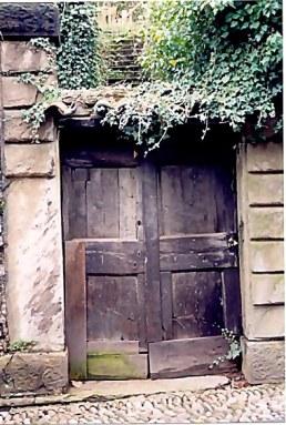 Bergamo Alta heavy door and stairway