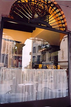Bergamo Alta reflected in café