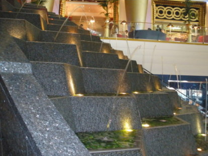 Fountain beside escalators at Burj Al Arab Dubai