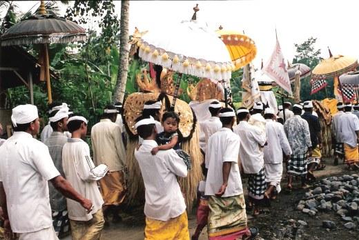Ceremonial procession Petulu White Heron village in Bali
