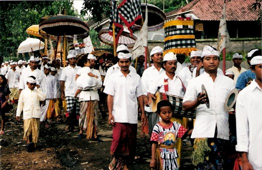 Ceremonial procession with cymbals at the Village of White Herons in Bali