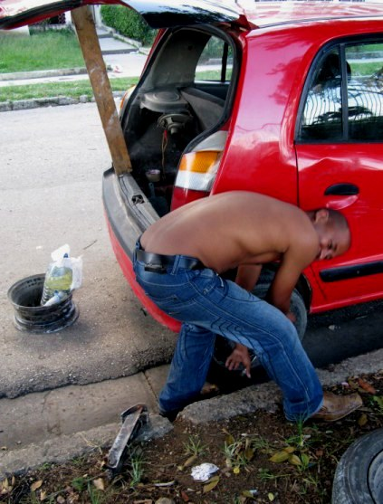 Changing tyre in Havana Cuba