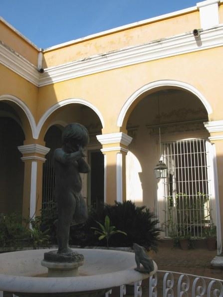 Cherub and frog fountain Palacio Cantero Trinidad de Cuba