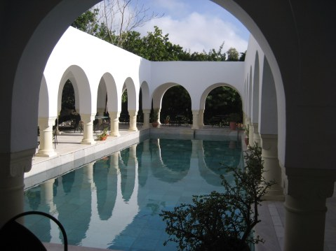 Colonnades around pool Dar Sebastian Hammamet Tunisia