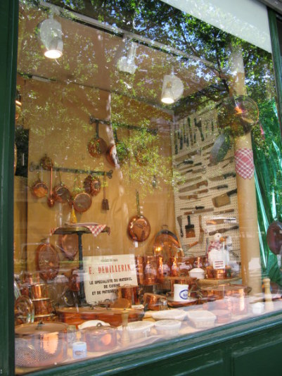 Copper pots in window of the Dehillerin shop for cooks in Paris