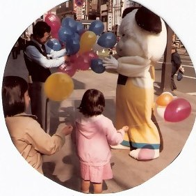 Costumed dog with balloons in Tokyo
