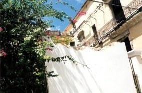 Former gerat house behind crumbling wall in Havana