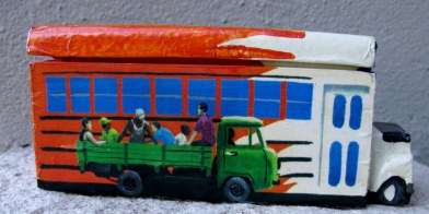 Cuban domino box with bus and truckload of people