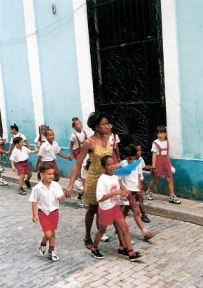 Cuban school chidren with teacher in Havana