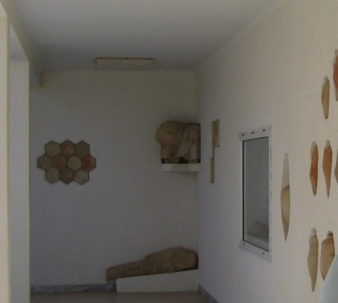 Display of pottery in museum at ruins of Kerkouane