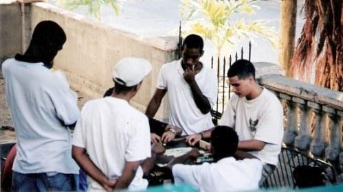 Domino game on verandah in Havana Cuba