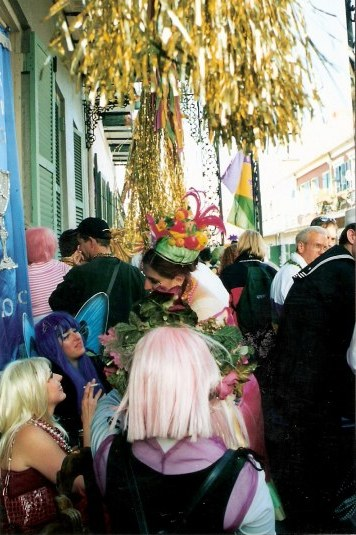 Elegant French Quarter balcony party during New Orleans Mardi Gras