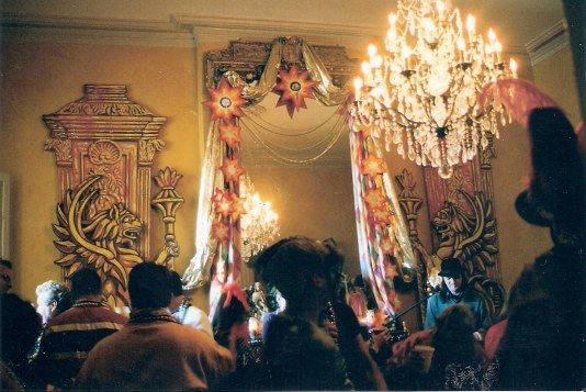 Elegant interior of French Quarter balcony party during New Orleans Mardi Gras