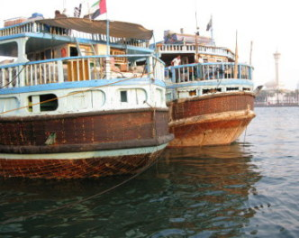 Emirati traditional wooden trading dhows Dubai Creek