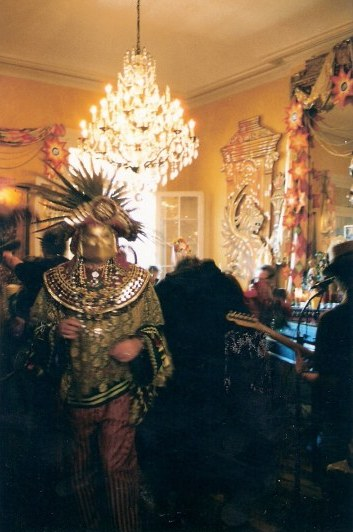 Exotic figure at French Quarter balcony party during New Orleans Mardi Gras