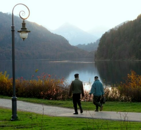 Fishermen arriving at Autumn beside Alpsee Hohenschwangau