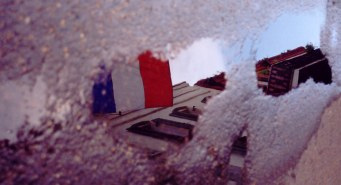 French flag reflected in puddle in the French Quarter New Orleans