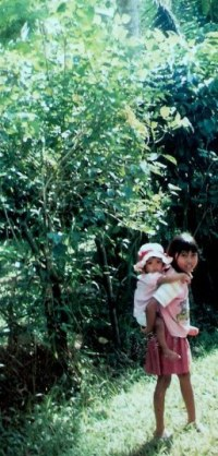 Girl carrying baby in Bali