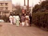 Girls in kimonos on suburban street – Tokyo
