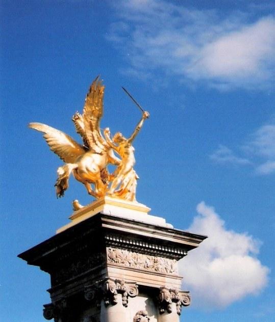 Golden statue of Fame restraining Pegasus Pont Alexander III