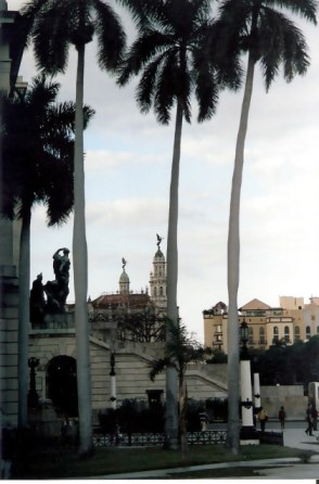 Havana Angel Of Gran Teatro Being Watched By Bronze Man