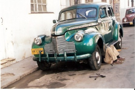 Havana-classic-car-with-repairman-underneath