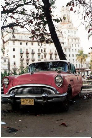 Havana-classic-red-car-on-the-Prado – Havana