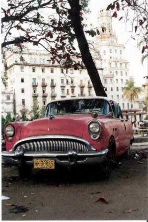 Havana-classic-red-car-on-the-Prado – Havana