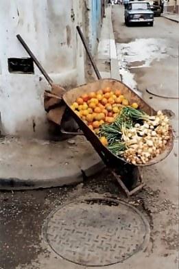 Fresh vegetable stall in wheelbarrow in Havana