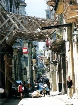 Timber bracing across street to hold up house wall in Havana