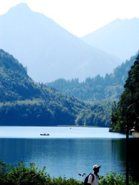 Hiker and canoe Alpensee Hohenschwangau Bavaria