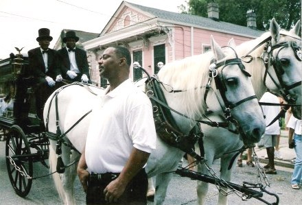 Horse-drawn hearse at Jazz Funeral New Orleans