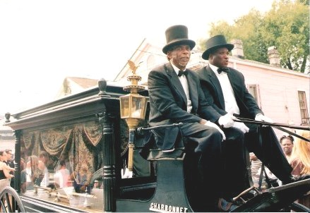 Horse-drawn hearse bearing coffin Jazz Funeral New Orleans
