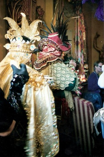 Jewelled costumes at French Quarter balcony party during New Orleans Mardi Gras