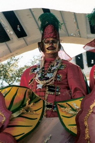 Masked Krewe member on New Orleans Mardi Gras float