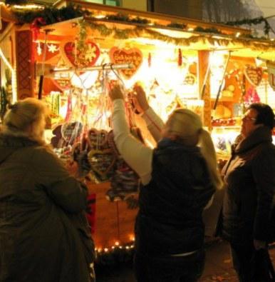 Munich Christmas Market choosing gingerbread heart