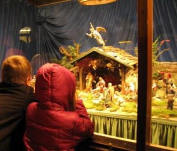 Munich Christmas Market children gazing at the nativity crib