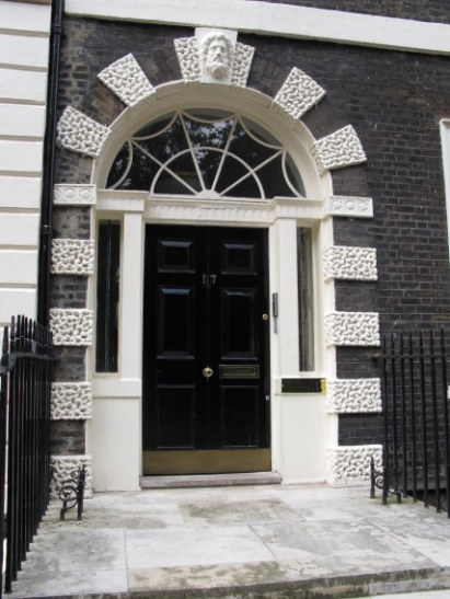 One of the duplicate-styled doorways on Bedford Square Bloomsbury