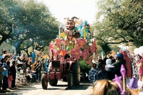 Outstretched hands and parade float at New Orleans Mardi Gras