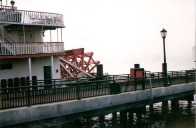 Paddle steamer and bridge in fog New Orleans