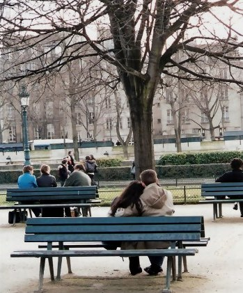 Lovers on Paris park bench