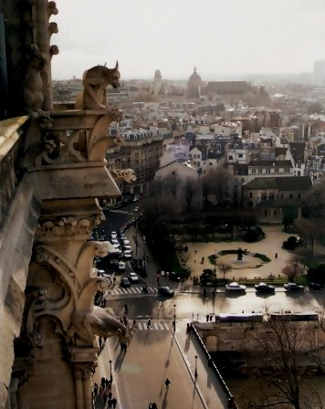 Notre Dame Cathedral Tower Gargoyle overlooking local park Paris
