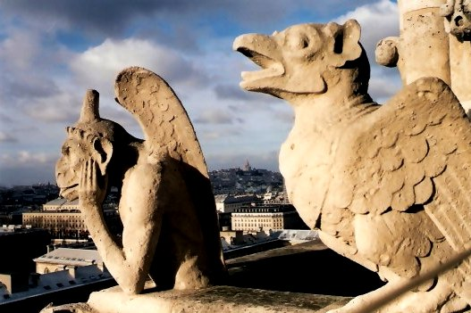 Gargoyle and Stone Bird on Notre Dame Cathedral  Tower