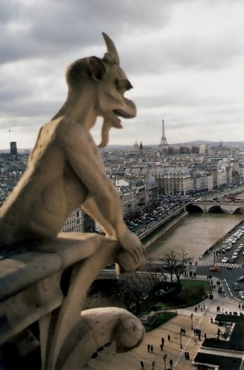 Gargoyle overlooking the River Seine Notre Dame Cathedral Paris