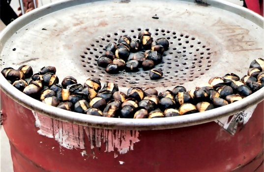 Chestnuts on red roaster Paris